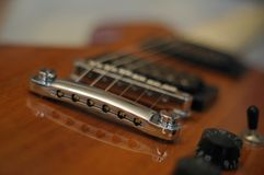 Streams and Bridges. Closeup shot of Washburn Idol WI-64 electric guitar with Tune-o-matic bridge royalty free stock photography