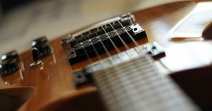 Streams and Bridges. Closeup shot of Washburn Idol WI-64 electric guitar with Tune-o-matic bridge stock photo