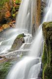 Streams and cascades of waterfall stock photography