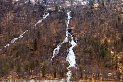 Streams of water coming down the mountain slope Stock Images