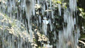 Streams of water fall down stock video footage