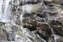 Streams of a waterfall on the rocks Royalty Free Stock Photos