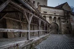 Streat leading to an old castle gate Royalty Free Stock Photography