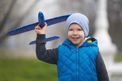 Free Streat Portrait Of The Preschool Boy Launching A Plane Stock Photography - 219088042