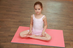 Streching little girl Royalty Free Stock Image