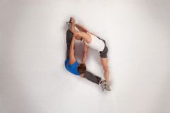 Streching with personal trainer. Overhead view of streching with personal trainer Royalty Free Stock Image