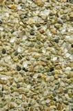 streckad pebblevägg royaltyfria bilder