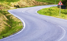Street. A dangerous curve in mountain stock images
