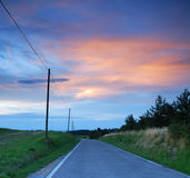 The street (2). A street in the country. At the sunset royalty free stock image