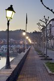 Street. Image of a long cold street with a line of lamppost Royalty Free Stock Photos
