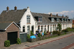 Street. In Harlingen(Holland) with a row of houses painted white Stock Photo
