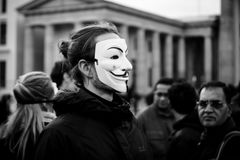 Street action of Berlin Vegans `Cube of Truth`. BERLIN - NOVEMBER 12, 2017: Street action of Berlin Vegans `Cube of Truth` in the Anonymous mask near Brandenburg Royalty Free Stock Image