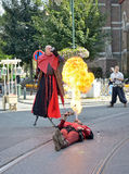 Street actor demonstrates fire-breathing Royalty Free Stock Photo