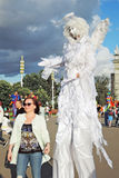 Street actor dressed like an angel poses for photos in Moscow Royalty Free Stock Photography