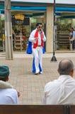 Street actor dressed like Elvis on Calcadao de Londrina. Londrina, Brazil - July 31, 2017: Street actor dressed like Elvis on Calcadao de Londrina making Stock Photos