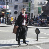 Street actor portraying Harry Potter, stands on the dividing line, crossing a road Royalty Free Stock Photos