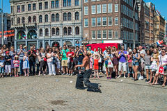 Street actor throws a sword Stock Photo