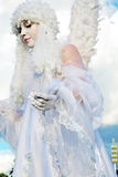 Angel woman. MOSCOW - AUGUST 01, 2015: Street actor woman dressed like an angel poses for photos in VDNH park in Moscow. He walks on stilts. Inspiration open air Stock Photos