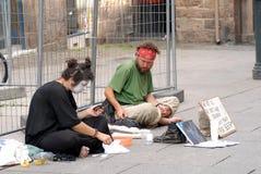 Street actors beg for beer Stock Image