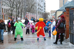Street actors playing with children Royalty Free Stock Photo