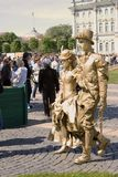 Street actors walk on Dvortsovaya Square in Saint-Petersburg city, Russia. Stock Photos