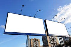 Street advertising. Two blank billboards on a street close up stock photos