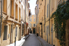 Street in Aix-en-provence. Plastered facades in traditional Provencal colors in Aix-en-provence Royalty Free Stock Images