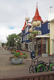 Street in Akureyri centre with blue house, flowerpots and bikes Royalty Free Stock Photo