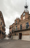 Street of Alaejos with town hall. Street with houses located on the sides of Alaejos Spanish city in Spain, is a cloudy day. It is a picture vertically, you can Stock Images