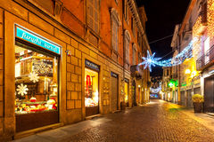 Street of Alba decorated for winter holidays. Royalty Free Stock Photo