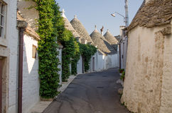 The street of Alberobello with trulli. Alberobello. Puglia. Ital Stock Photos
