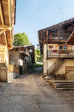 Street in Albertville. In the Alps mountains of France with trees of  in a sunny day. It´s a vertical picture Royalty Free Stock Images
