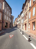 Street of Albi. Street in the French city of Albi houses with windows on a sunny day, is an image vertically Stock Photos