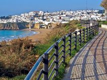 Street in Albufeira in Portugal along beneath the ocean stock images