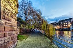 Street alongside a water canal in Strasbourg. Street alongside a water canal in Petite France, Strasbourg Royalty Free Stock Images