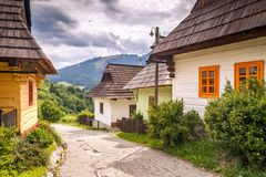 A street with ancient houses in the village of Vlkolinec. royalty free stock photo