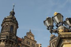 Street antique forged iron lamps and tower Royalty Free Stock Photography