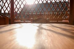 A street arbor. Wooden table. Sun Royalty Free Stock Photography