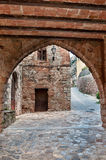 Street with an arch, Collbato, Spain Stock Images