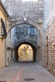 Street with arches in the village of Castries, France. The historic village of Castries, in Languedoc, south of France, has many typical streets with arches royalty free stock photo