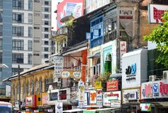 A street archtecture view with colonial building in the town of Yangon. Yangon, Myanmar - March 9, 2015: A street archtecture view with colonial building in the Royalty Free Stock Image
