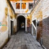 Street with archway in Venice Royalty Free Stock Images