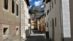 Street in Ardez (Graubünden, Switzerland). One of the many beautiful streets in the village of Ardez (Graubünden, Switzerland Stock Photography