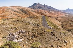 Street in an Arid Valley. From the Mirador Astronomico de Sicasumbre in a sunny clear day - Fuerteventura - March 2017 Royalty Free Stock Image