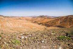 Street in an Arid Valley. From the Mirador Astronomico de Sicasumbre in a sunny clear day - Fuerteventura - March 2017 Royalty Free Stock Images