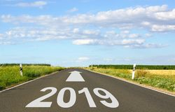 2019 - street with arrow and year - the future stock photos