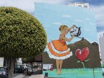 Street Art –Girl gardening a heart. Royalty Free Stock Photo