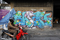 Street Art. Graffiti piece by Bangkok based artist Noona on a wall in central Bangkok on Dec 28, 2011 in Bangkok, Thailand. Noona's work can be seen on streets Stock Photos