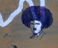 Street art - Afro Hitler. Street art with painting on wall with Hitler with afro hair style royalty free stock image