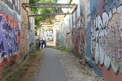 Street art corridor in Uzupio, an artistic district in Vilnius, Lithuania Stock Photography